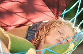 Child sleeps in a hammock in the garden. — Stock Photo