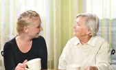 Senior woman with her granddaughter talk to each other. — Stock Photo
