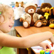 Little girl painting hands in her room. — Stock Photo
