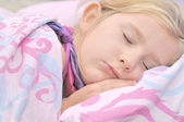 Child sleeping in bed. — Stock Photo