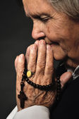 Praying senior woman. — Stock Photo