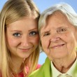 Grandmother and granddaughter, senior and young women. — Stock Photo