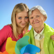 Stock Photo: Grandmother and granddaughter, senior and young women.