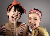 Two women singing together. Karaoke, retro style. — Stock Photo