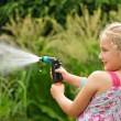 Young girl watering plants in the garden. — Stock Photo #28321121
