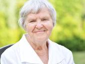 Senior woman in garden. — Stock Photo