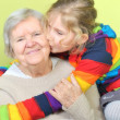 Stock Photo: Senior woman with her granddaughters. Happy and smiling.