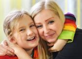 Young mother and daughter. Happy family. — Stock Photo