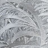 Frosty patterns on glass. Winter background. — Stock Photo