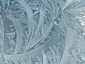 Frosty patterns on glass. Winter background. — Stockfoto