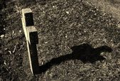 Cross on abandoned cemetery — Stock Photo