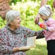 Grandmother and granddaughter. Happy and smilling family. — Stock Photo #48586697