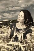 Woman on field of grain. — Stock Photo
