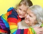 Senior woman with her granddaughters. Happy and smiling. — Stock Photo