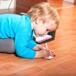 Stock Photo: Little boy drawing on sheet of paper