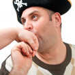 Portrait of a man in a pirate hat — Stock Photo