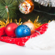 Royalty-Free Stock Photo: Hat of Santa Claus and balls on Christmas tree background