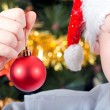 Portrait of a boy on the background of the Christmas tree — Stock Photo
