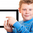 Boy with a tablet computer - Stock Photo