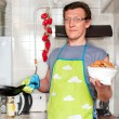 A man in the kitchen preparing - Stock Photo