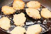 Cooking fried potato pancakes — Stock Photo