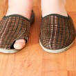 Ragged slippers on his feet in a child — Stock Photo