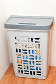 Basket for storage of laundry at home — Stock Photo