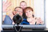 Family speaks on the video link. — Stock Photo