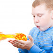 Boy blowing up the sun in the palms — Stock Photo