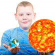 Boy holding the sun and the terrestrial globe. — Stock Photo