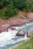 Wild River at the beautiful mountain valley — Stock Photo