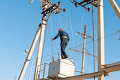 Electricians performs work at height — Stock Photo