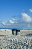 Garbage cans on beach — Stock Photo