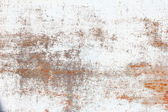 Old worn wall with whitewash and rust — Stock Photo