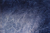 Blue jeans texture with seams. — Stock Photo