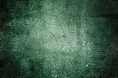 Concrete wall with cracks grunge texture in green color — Stock Photo