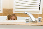 Happyliy Hiding In the Bath Tub — Stock Photo