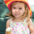 Cute little girl eating her ice cream — Stock Photo
