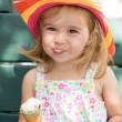 Stock Photo: Cute little girl eating her ice cream