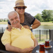 Loving senior couple having drinks — Stock Photo