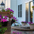 Brick Patio and Pillar with Flowers — Stock Photo