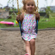 Little Girl Swinging after a Meal — Stock Photo