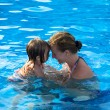 Mother and Daughter Having Fun Time in the Pool — Stock Photo