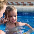Mother and Daughter Playful in the Pool — Stok fotoğraf