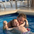 Mother and Daughter Playful in the Pool — Foto de Stock
