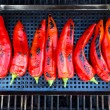 Chillies getting ready to be grilled on grill — Stock Photo #30359431