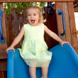TwoYears Old Girl Fulfilled on the Slide — Stockfoto