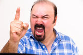 Angry middle-aged man screaming and threatening — Stock Photo