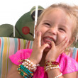 Child sitting and laughing — Stock Photo