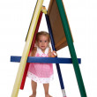 Cute little girl playing on an A-frame — Stock Photo